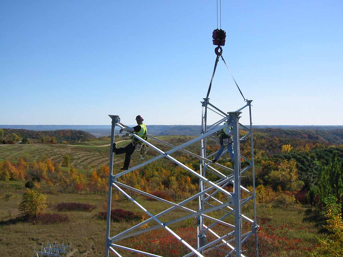 MnDOT worker constructing a radio tower