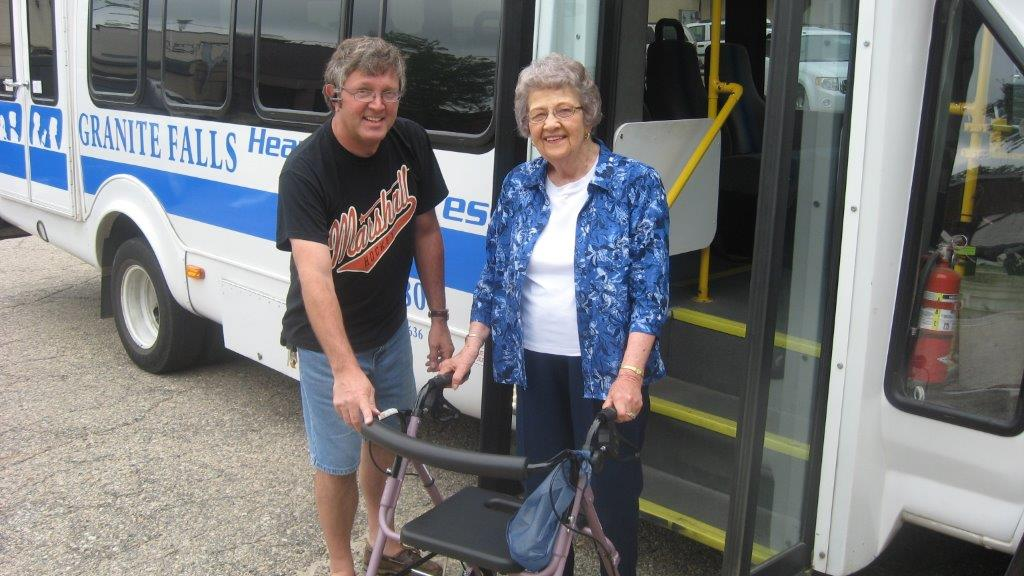 Greater Minnesota provider helping an elderly passenger off the bus